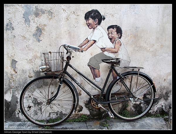 Ernest Zacharevic Mirrors George Town mural - Little Children on a bicycle