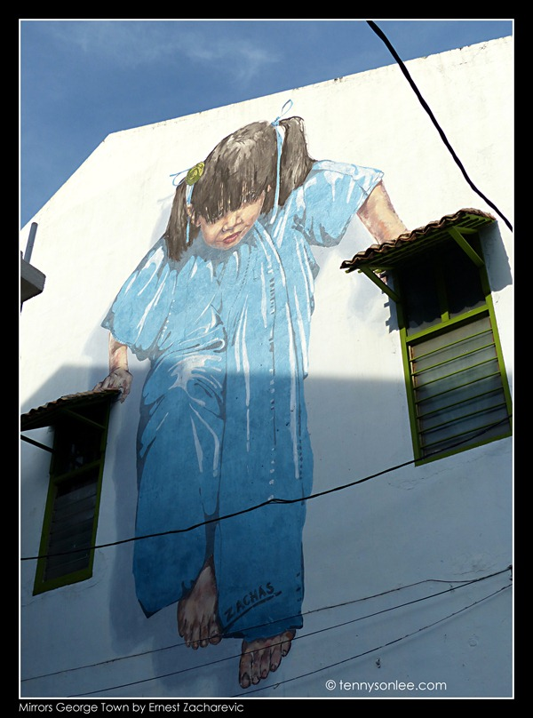 Ernest Zacharevic Mirrors George Town mural - Little girl in blue