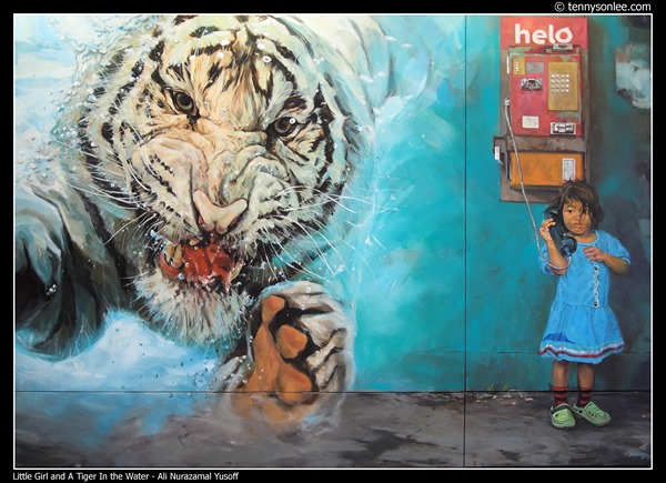 Little Girl and A Tiger In the Water by Ali Nurazamal Yusoff